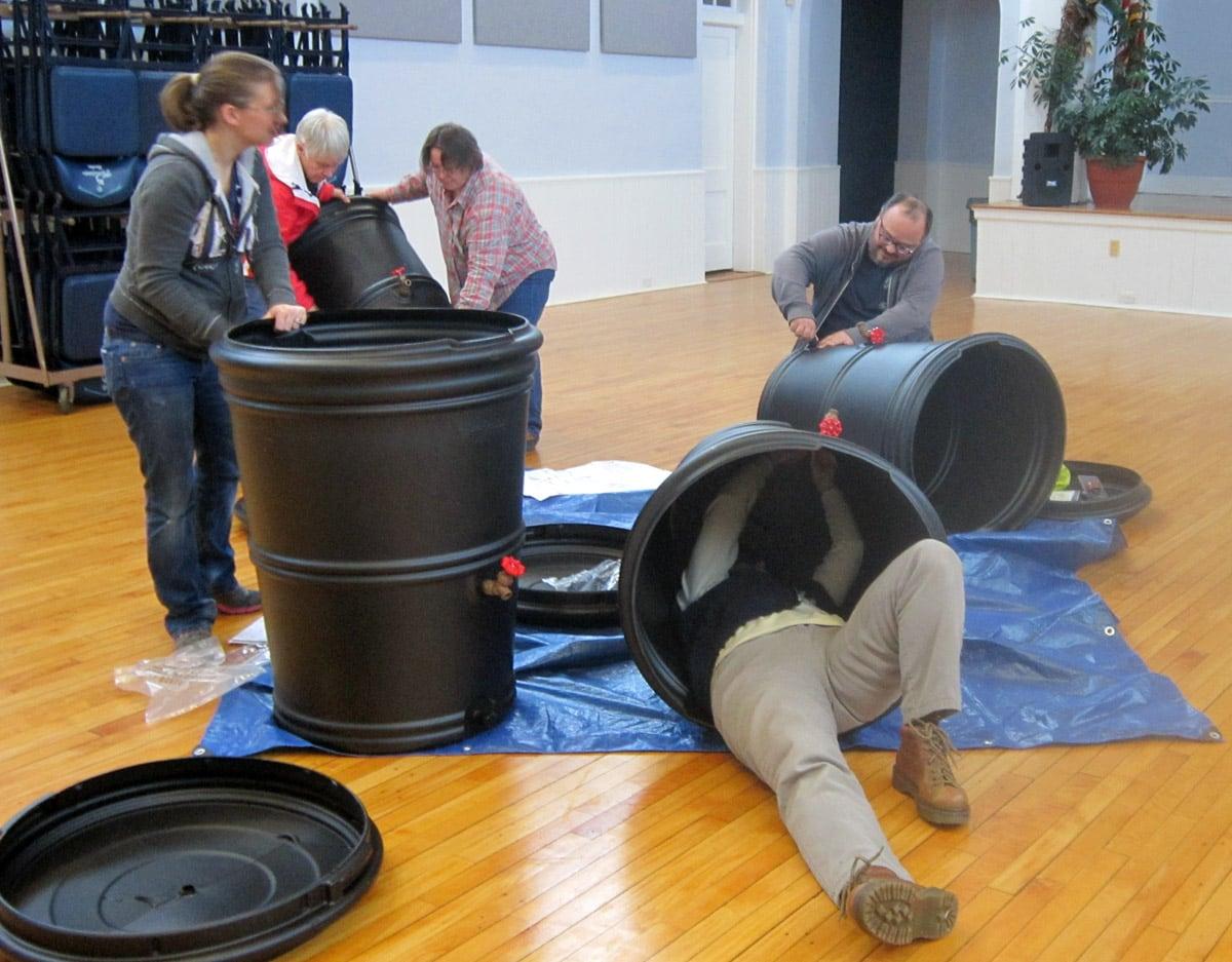 Participants construct rainbarrels during workshop